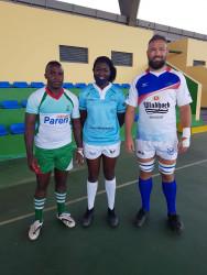 Captains of Namibia and Madagascar with the referee Precious Pazani.jpeg