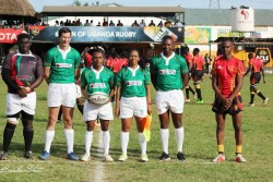 Referees and Ghana and Uganda captains.jpg