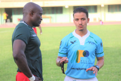 Societe Generale and a Cameroonian Rugby Player In Discussion Mid Game .JPG