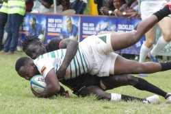 Uganda's Aaron ofoiwroth with a try saving tackle.JPG